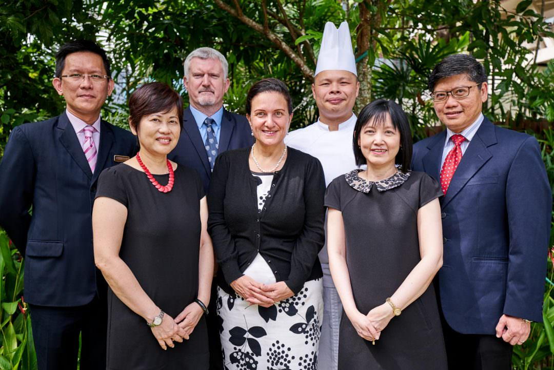 corporate portrait of head group with greenery at tanglin club in singapore