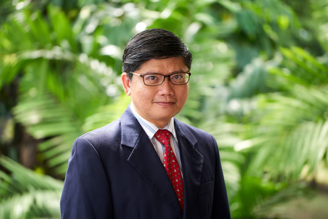 corporate portrait of distinguished asian male staff at tanglin club in singapore